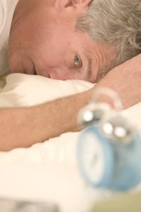 Man Waking to Alarm Clock